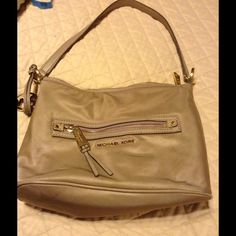 MK nylon shoulder bag MARKDOWN AUTHENTIC Tan nylon MK bag with gold hardware. Gently used lots of life remains in this bag. Michael Kors Bags Shoulder Bags
