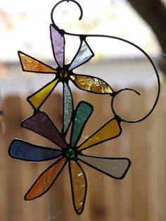 Pretty Pair of Stained Glass Flowers Suncatcher by newmoonglass, $35.00                                                                                                                                                                                 More
