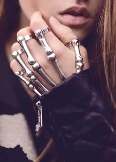 Skeleton Hand Bracelet No bone picking here! This Skeleton Hand Bracelet is so freakin' cool. Using high quality metal alloy that resists corrosion and tarnishing, this amazing hand bracelet is definitely unique. Formed into a silver tone skeleton hand Skeleton Hand Bracelet, Skeleton Hands, Hand Jewelry, Silver Jewelry, Unique Jewelry, Silver Ring, Black Silver, Silver Bracelets, Silver Earrings