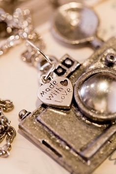 Camera Pendant...Really like this for a few people I know