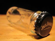 Shot-glass-made-from-a-cut-Jack-Daniels-Country-Cocktails-malt-beverage-bottle