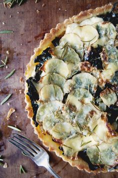 ROSEMARY POTATO KALE TART - The Kitchy Kitchen Excellent flavor. Start onions before pie crust. Potatoes really do need to be sliced that thin, or plan on adding a lot more baking time!