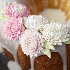 Dahlia flowers are a wonderful addition to cakes and cupcakes, and they're beautiful in almost any color.  Use specialty decorating tip 81 to create stand-up petals that make it look like your flower is blooming.