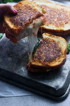 Pizza Margherita Grilled Cheese -- All the flavors a margherita pizza stuffed between two slices of buttered bread. cookingforkeeps.com