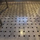 Black and white floor tiles for the bathroom have a long history. They were popular during the Victorian times and during the Arts and Crafts period. The style has been copied in vinyl form, but there are many elegant versions available today. White hexagon tiles can be used with contrast dots, or with contrast circles which look like flowers. Or you can go with simple square tiles in various sizes and patterns. And then there is the pinwheel design, with its lovely geometric symmetry.