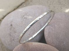 Silver Meteorite Bangle: Hammered Silver by CuriousMagpieDesigns