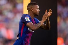 Nelson Semedo of FC Barcelona enters the pitch ahead of the Joan Gamper Trophy match between FC Barcelona and Chapecoense at Camp Nou stadium on August 7, 2017 in Barcelona.