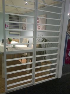 Burglar bars designed to look like shutters! So clever!