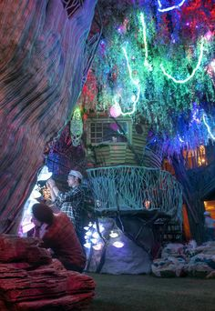 Santa Fe, NM - Visitors tour a jungle-like section of Meow Wolf's House of Eternal Return that opens to the public this weekend. Meow Wolf Santa Fe, Places To Travel, Places To See, Bühnen Design, Eternal Return, Travel New Mexico, Decoration Plante, Land Of Enchantment, Fantasy Landscape