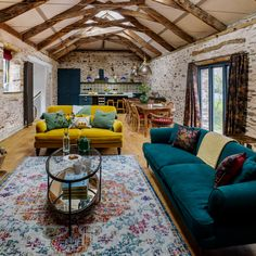 Barn conversion living room with stonewalls, vaulted ceilings and colourful sofas Mustard Living Rooms, Teal Living Rooms, Living Room Images, Colourful Living Room, Eclectic Living Room, Beautiful Living Rooms, Living Room Colors, Living Room Modern, Living Room Sofa