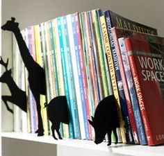 animals jumping out of books.  I can picture an entire non-fiction section decorated like this