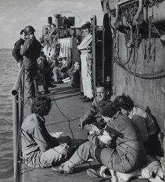 US Army nurses, bound for France, enjoy a game of Bridge as they cross the English Channel, 1944.