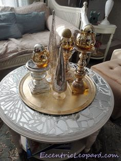Mosaic mirror table, I wouldn't put that center piece there though, distracts it from the true centerpiece!