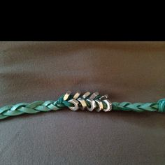 Aqua leather with silver hex nuts braided in.