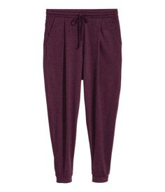 Burgundy. Jogger-style pants in soft, gently draped jersey with elasticized drawstring waistband, side pockets, and ribbed hems.