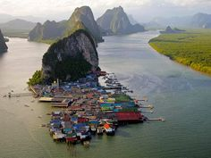 """10 Incredible Water Towns & Villages from """"THE WORLD GEOGRAPHY."""" The photo is Ko Panyi, Thailand."""