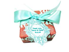 "This gorgeous Mint and Orange wrapped beautiful handmade soap favor adds just the extra touch of class you are looking for. Your friends and family will be in delight when they open these one of a kind handmade soap favors. Who doesn't love gorgeous handmade soap? Right!    Choose any one of our soaps to be wrapped in this pretty orange and mint dahlia designer paper, we'll then adorn it with a satiny mint ribbon and a custom ""wedding"" handmade tag.  Pick from over 45 different scents.  List…"
