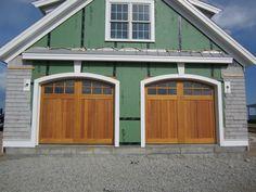 @clopaydoors Reserve Collection Wood Carriage House Style Garage Doors, Design 2 with Arch3 Glass. Installed by Mortland Overhead Door. mortlanddoor.com