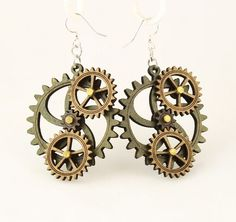 """Made in U.S.A Style # 5005F Size 1.65"""" x 1.5"""" Kinetic Gear Earring 5005F All Gears Move! Comes as shown - Apple Green/Tan/Brown Made from sustainably sourced materials Laser-cut wood Stained with water based dye Ear wires are silver-finished 3041 stainless steel with new electrophoretic-coating that resists tarnishing"""