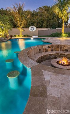 A swim-up bar with underwater stools was added to the side of the pool near the sunken fire pit.