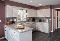 The mix of cabinet door and drawer styles is perfect for this contemporary transitional kitchen.