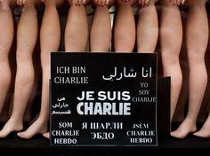 """""""Je suis Charlie"""" : ceci n'est pas une marque [Une pancarte avec le slogan """"Je suis Charlie"""" en plusieurs langues à Paris, le 12 janvier 2015 (Revelli-Beaumont/SIPA)]"""