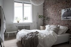 Exposed brick in this cosy bedroom