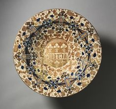 """c. 1437 plate with the name """"Maria"""" (Spain, Valencia) - tin-glazed earthenware, gold lustre (diam. 18 3/8. x 2 1/4 in.) - Cleveland Museum of Art 1944.292"""