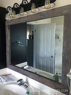 One of the quickest and easiest ways to add character to a boring bathroom is to add a stick on mirror frame. Paint it all one color for a sleek look,. DIY Stick-On Mirror Frame, Bathroom Interior, Home Interior, Modern Bathroom, Master Bathroom, Guys Bathroom, Peach Bathroom, Parisian Bathroom, Lavender Bathroom, Neutral Bathroom