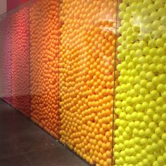 I could see this as a bar, filled with rainbow golf balls behind plexiglass.  What fun.