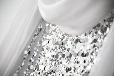 """Wedding Arch Ideas: """"This altar piece was made from pieces of mirror being cut into small circles and strung on beading wire. It reflects the light perfectly and looks almost like diamonds. I like the extra touch of the tulle on the sides of the piece to give it softness."""""""