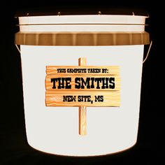 This bucket light features a rustic wooden sign with the wordsThis Campsite Taken By, along with your family name and hometown in a chunky Western font.    We can customize this bucket light with your own combination of words and/or images.