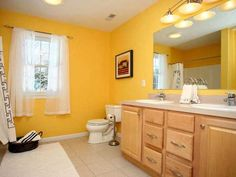yellow paint and wood bathroom furniture