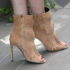 Fringe!: Really, we can't get enough fringe this Summer! From bag embellishments to long scarves to tasseled booties, we're loving this trend.