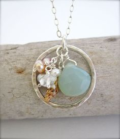 Hawaii shell sterling silver circle necklace with seafoam blue chalcedony