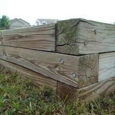 How-to build a raised gardening bed- I think this is really the way to go for us!  We will give it a go with the garlic planting this fall and see how it works out!