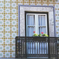 Beautiful details... Walking down the street of Santa Marta. #Lisbon #Portugal #facade #buildingfacade #facade #oldbuilding #flowers #fence #balcony #tiles #tileaddiction #yellow #ceramics #door #welovelisbon #lisboa #santamarta #travel #travelphotography by thebckt