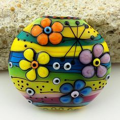 not a rock, but I like the pattern and colors to paint on a rock.