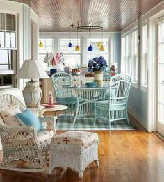 Have an indoor porch? See these cozy cottage porch filled with wicker accessories, flowers and soft bright colors from BHG. Cottage Porch, Cozy Cottage, Cottage Living, Coastal Cottage, Lake Cottage, Porche Chalet, Home Interior, Interior Design, Coastal Interior