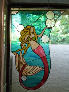 red mermaid - another inspiration from a watercolor painting.  she is featured in my large master bath window on the left side - accompanying the blue mermaid.