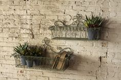 set of two ornate wire wall planters