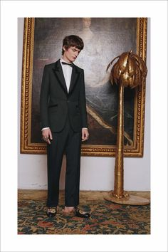 A black wool mohair military twill tailored suit and Princetown slipper with tiger from Gucci Cruise 2017 by Alessandro Michele.