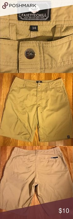 Fayettchill Men's Shorts These are Fayettchill shorts. My fiancée wore them one time and a friend of his flicked a cigarette cherry on him at a restaurant and it burned a tiny hole as shown in the picture. These shorts were originally $56 but due to the damage we are asking for A LOT less. They'd be great for the lake or fishing. Same day shipping! Fayettchill Swim Hybrids