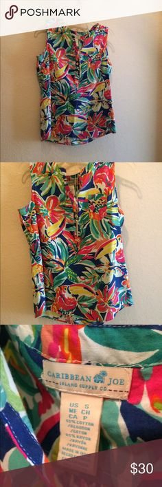 Caribbean Joe sleeveless blouse Tropical island here I come!! Bright and bold sleeveless blouse. Perfect for vacation.  Gold buttons add some flair! Smoke free home caribbean joe Tops Blouses