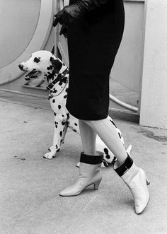 Early 60s boots partner with a darling Dalmatian in this great fashion shot.