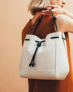 The von Holzhausen Bucket Bag in White & Black   luxury handbags   bucket bags   two-toned bags