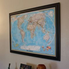 Blue World Travel Map with Pins and Black Frame. $99.99, via Etsy.