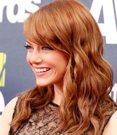 Emma Stone's perfectly copper Aloxxi Hair Color Personality Amaretto Perfetto®   red hair   redhead   red hair don't care   celebrity hair   hair color inspiration   hair style inspiration   long hair   waves   side-swept bangs