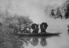 The Richards Family,  circa 1900,  on a small boat on the Little Kanawha River in West Virginia.  From left to right, is father Frank Richards with a guitar;  Ghela, daughter, with the banjo; Frank Jr., with the guitar; and Roy with the fiddle.