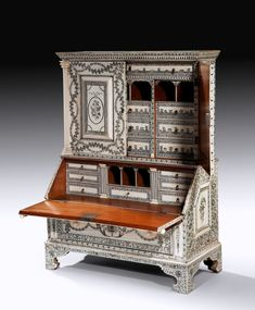 A superb Anglo Indian miniature sandalwood and ivory bureau cabinet, made in Vizagapatam, India at the end of the 18th century. The rectangular top with a faux-dentil cornice over two doors flanked on either side by architectural columns, more info @